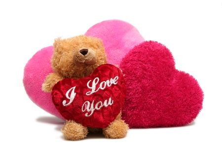 Teddy bear with soft hearts on a white background Stock Photo