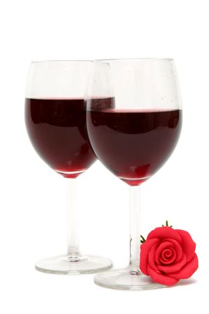 Glass of rd wine on a white background photo