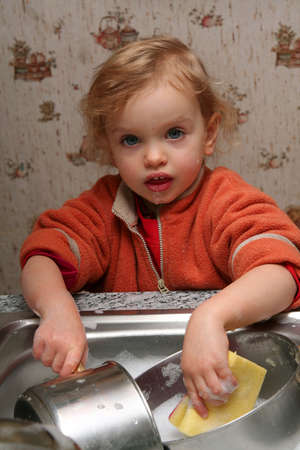 Little  washing the dishes in the kitchen Stock Photo - 736757