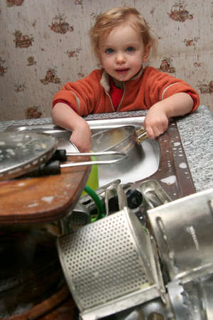 Little  washing the dishes in the kitchen Stock Photo - 736756
