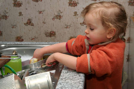 Little  washing the dishes in the kitchen Stock Photo - 736755