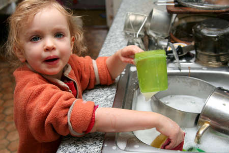 Little  washing the dishes in the kitchen Stock Photo - 736753
