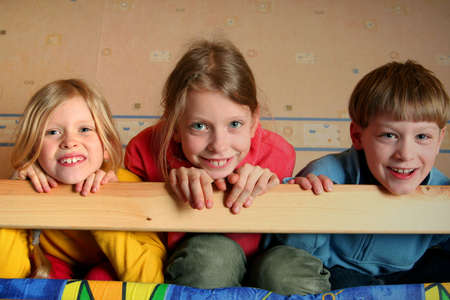 Happy children in childs room on a bunk-beds Stock Photo