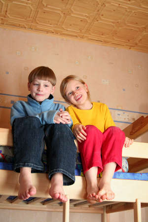 Happy children in child's room on a bunk-beds Stock Photo - 750507