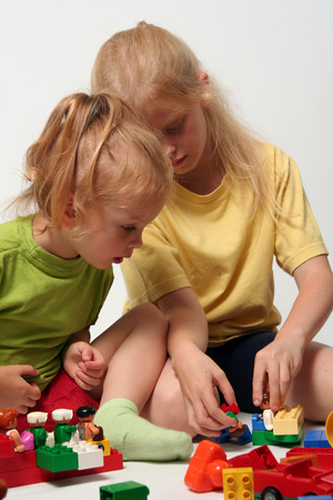 Little children playing with colorful cube blocks Stock Photo - 1478914