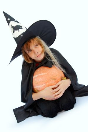 Young blond girl dresses in hallowwen witch costume.
