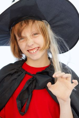 Young blond girl dresses in hallowwen witch costume. photo