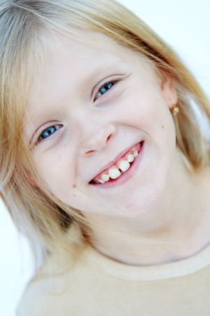 Little blond girl with beautiful blue eyes photo