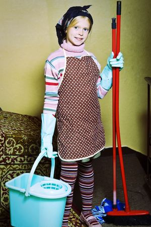 Little girl cleaning an old dirty house Stock Photo - 4535713