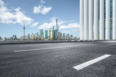 empty asphalt road with city skyline background,shanghai,china.