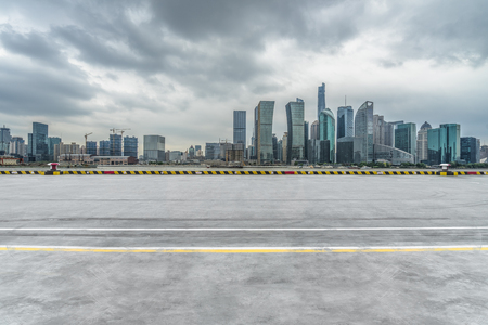 empty road floor with cityscape in Shanghai,China. Stock Photo