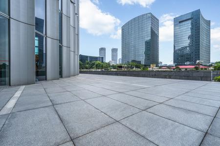 cityscape and skyline of shanghai from empty brick floor Stock Photo