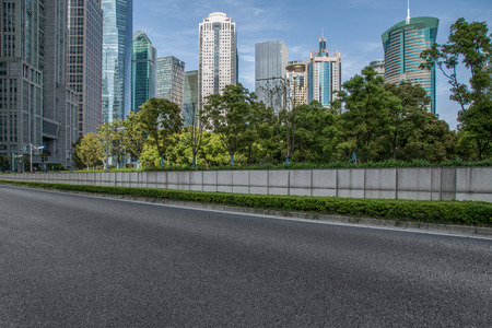 urban traffic road with cityscape in background in Shanghai, China.