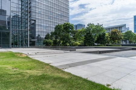 modern office buildings near meadow in midtown Stock Photo