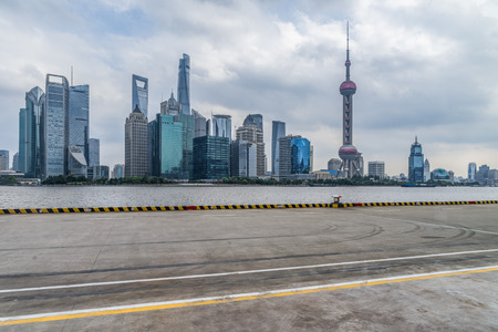cityscape and skyline of shanghai from empty urban road