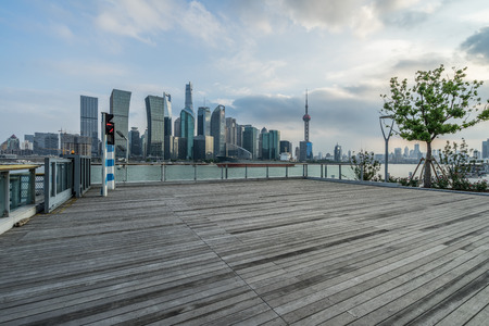 Empty wooden footpath with cityscape and skyline of shanghai Stock Photo