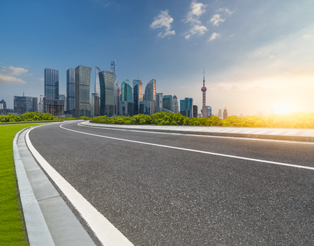 cityscape and skyline of shanghai from empty asphalt road