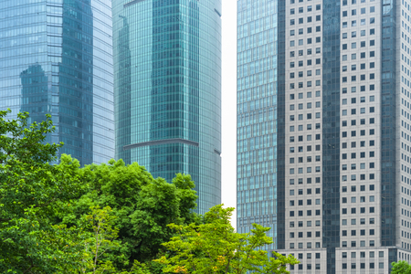 modern office building with green trees Stock Photo