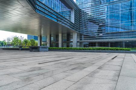 empty brick floor front of modern building
