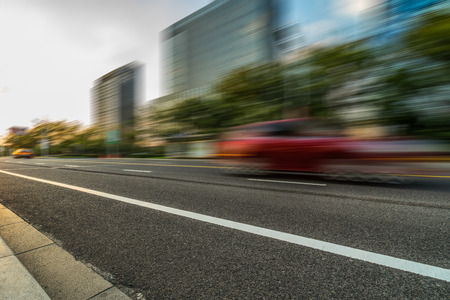 cars driving on inner city road of suzhou,china,asia. Stock Photo