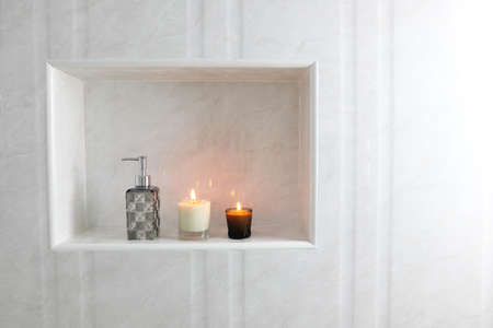 The luxury lighting aromatic scent glass candle display decorate in the luxury design white toilet bathroom of the hotel resort