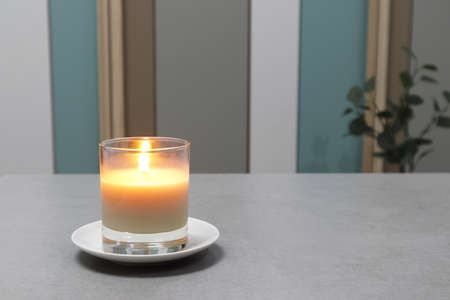 The luxury lighting aroma scented amber color glass candles are displayed in the minimal design bed roomh