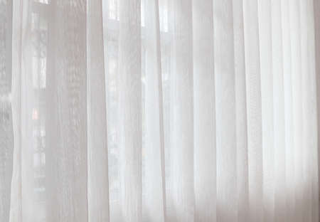 nice white curtain in the nice white bedroom in the luxury hotel resort in Thailand Stock Photo