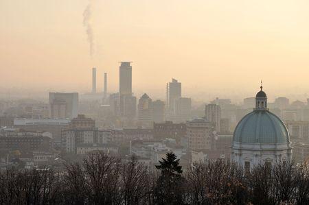 foggy city skyline, brescia