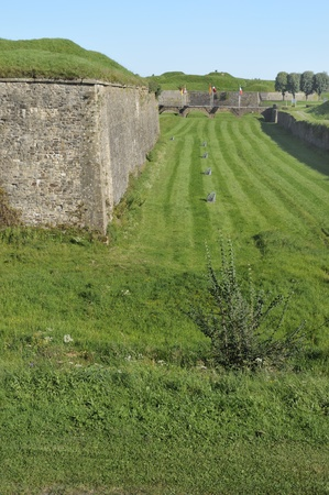 foreshortening: moat and city wall, rocroi, ardennes
