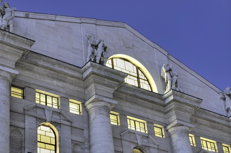 building monumental: view of upper part and gable of monumental stock-exchange building in city cente, shot at dusk
