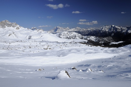 snow and rocks, san pellegrino pass, dolomites