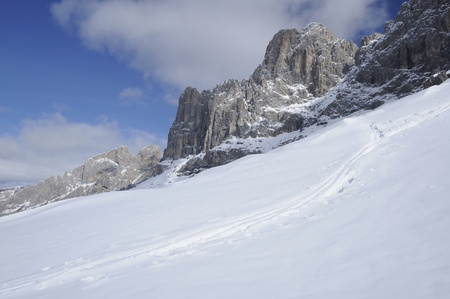 snowy slopes under rosengarten, dolomites photo