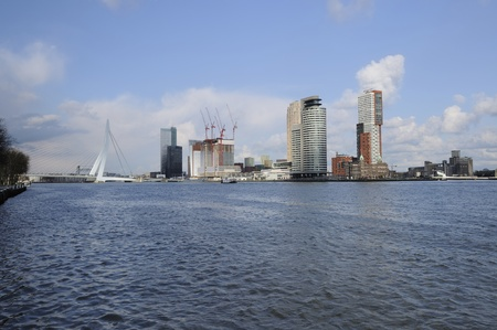 maas: maas waterfront, rotterdam     cityscape with new downtown architectures on river waterfront, shot in bright spring light from west toward east