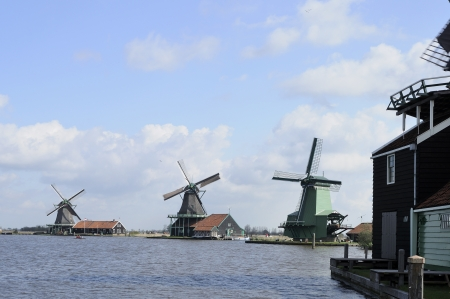 location shot: windmills, zaanse schans                          view of traditional windmills at touristic location, shot in bright spring light