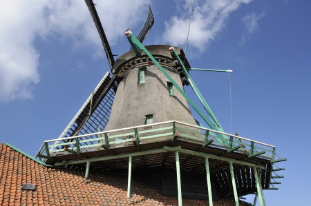 location shot: windmill detail, zaanse schans                    detail of upper part  of traditional windmill at touristic location, shot in bright spring light Stock Photo