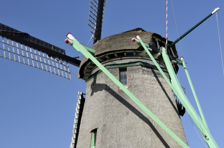 location shot: windmill mechanism, zaanse schans                  detail of mechanism that moves the vanes of traditional windmill at touristic location, shot in bright spring light
