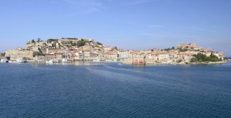 Portoferraio cape, Elba      cityscape of the cape and the harbour of village on island in mediterranean sea, shot in bright light Stock Photo - 17035705