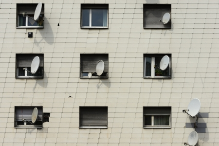 satellite dish rhapsody, Stuttgart                  detail of white facade with a lot of satellite dish near windows Stock Photo - 17092316