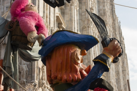 papiermache: papier-mache pirate and Minster, MILAN, ITALY - FEBRUARY 16: papier-mache pirate  on vessel in parade, in background blurred Minster. Shot at Kid