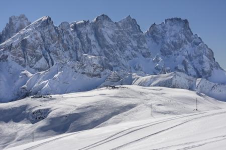 ski runs:  Pale range north side, San Pellegrino pass; white view of ski area and important mountain range, shot under deep blue sky