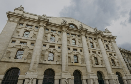 building monumental: gloomy clouds over stock exchange, Milan; view of monumental stock-exchange building in city center, shot under dark cloudy sky resembling the actual  mood of financial world