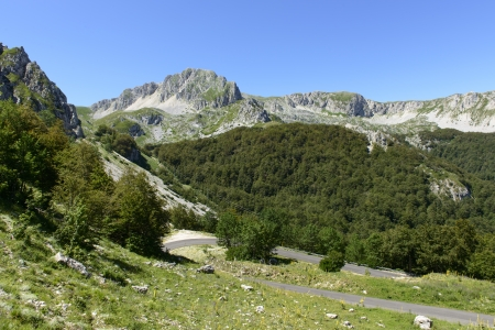 rieti: north eastern side of Terminllo and Leonessa road, Rieti; summer view of the north eastern cliffs of high mountain near the town and of the road that leads to Leonessa, shot in bright summer light