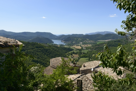 rieti: Piediluco lake from Labro, Rieti; aerial view of the green  Rieti  holy valley , so called since san Francesco lived there, shot in summer from Labro village looking toward north and beautiful Piediluco lake; in foreground terracotta tile roofs
