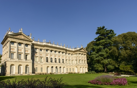 neoclassic: view of beautiful neoclassic palace and its park in Milan city center, shot in bright summer light from City Council garden Editorial