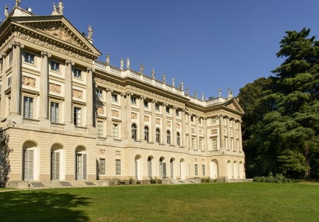 neoclassic: view of garden facade of beautiful neoclassic palace and its park in Milan city center, shot in bright summer light from City Council garden