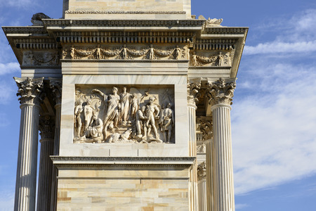 marble frieze at Arco della Pace, Milan, detail of marble monument  originally built to celebrate the arrival of Napoleon in town in 1807, shot  in bright winter light photo