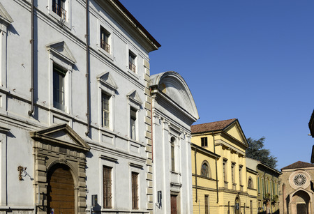 neoclassic: neoclassic buildings in old street, Lodi, Italy; foreshortening  of neoclassic facades in a street of the small town ; shot in bright winter light