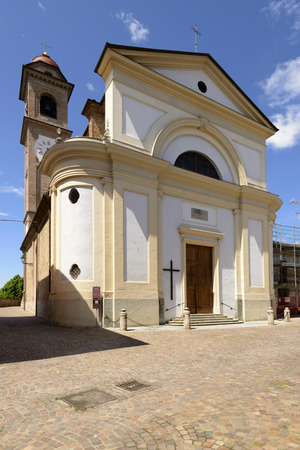 Holy Virgin Church, Volpedo, Italy  main facade of parish church in small village in Piedmont, shot in bright spring light