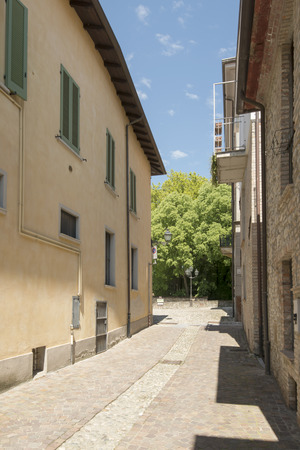 foreshortening: street in village center, Volpedo, Italy  foreshortening of old street in ancient small village in Piedmont, shot in bright spring light