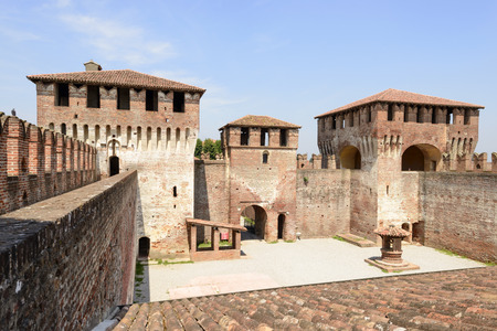 sforzesco: massive towers in main courtyard, Soncino Castle, view of the massive towers that close the north side of main inner court in the ancient Sforzesco Castle, shot in bright light